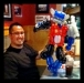 A customer at Pizza Hut with an Optimus Prime balloon.