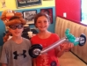 2 customers with a Monkey Hat & a Chopper at Prince's Hamburgers.